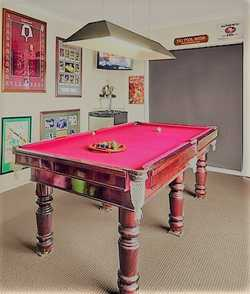 Full slate table, 8x4, maroon felt, turned legs. Great condition. No rips in felt. Pool balls, snook...