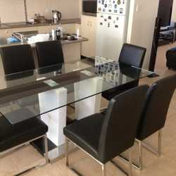 7 piece dining room suit for sale in good condition.