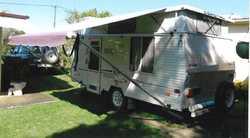 05 Coromal 4.55m poptop, island bed, a/c, solar,led lights, stovetop gas & elect, 3 way fridg...