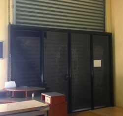Double glass sliding doors. Fits behind 3 metre wide roller door. 2.4 metres high. Dismantled ready...