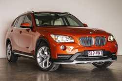 BMW X1 auto, E84 model (the last rear wheel drive X1), 2.0L petrol engine, Valencia orange with beig...