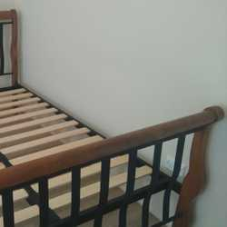 Dble bed and innerspring mattress. near perfect. Wooden ends and wood slat base
