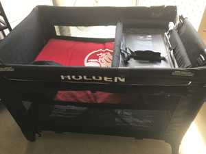 Holden portable cot with big side pocket, change table, VGC
