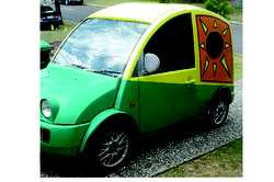 NISSAN S-CARGO IMPORT Bright yellow & green van with circular windows with sun. Sell unreg, a...