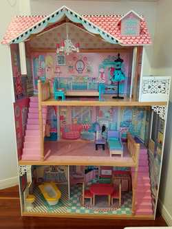 A beautiful wooden, 3 level doll house from Early Learning Centre (ELC - UK). Has been treated with...