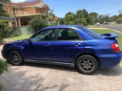 Subaru Impreza RS 2003 , blue sedan, 314,000kms $2000 ONO ph 0477299743 BJ95ES