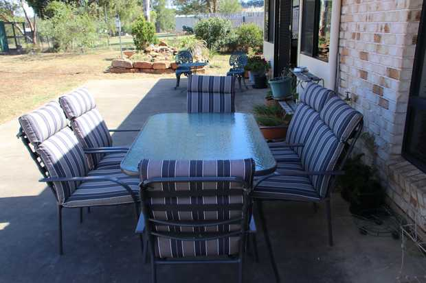 Outdoor setting -  seven piece, excellent condition. 150cm X 90 cm Glass table top. Stackable...