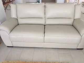 3 seater leather sofa in neutral colour purchased from Plush less than one year old and barely used.