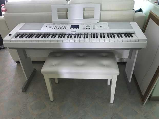 Near new Yamaha Portable Grand Electric Piano.  Sounds like a concert grand piano.  Includes seat...