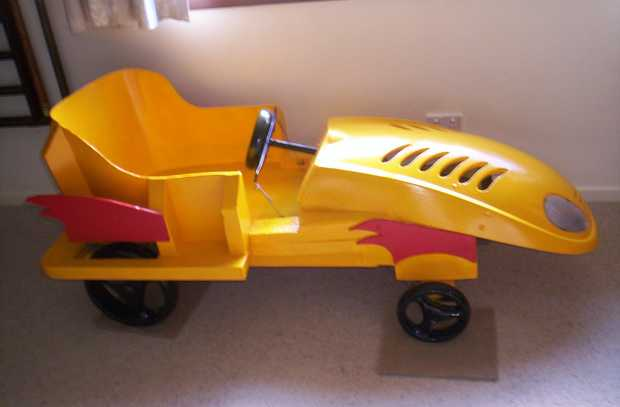 Tradesman built, unique push car will take 2 kids safely, controlled by adult.  Bright yellow. ...