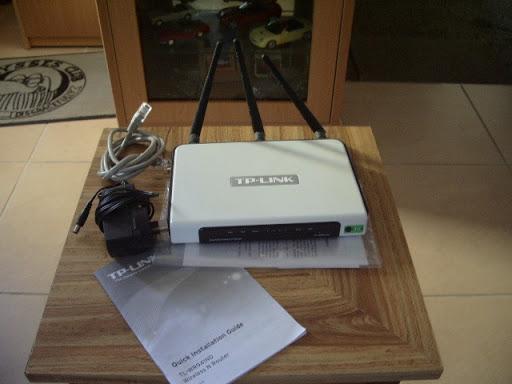 Model TL-WR94IND 300Mbps. 4 Lan ports. Works well.