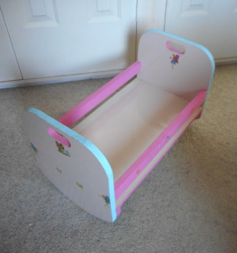 Lovely pink, white and pale blue doll's rocking cradle decorated with fairy stickers. Your little one...