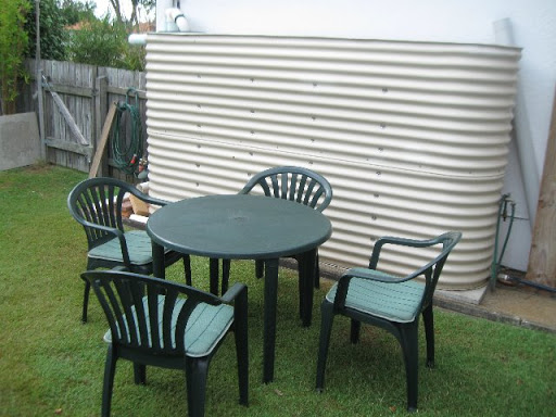 Here's a robust heavy-duty plastic outdoor table and 4 chairs. All in excellent condition, including...