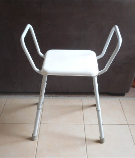 Shower chair in good used condition. Height adjustable.
