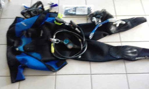 Wetsuit (med) 2 piece 3 mill, regulator, gloves, mask, fins, snorkel. Can sell separate.