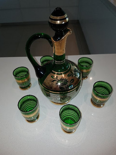 Green gold embossed decanter.Six (6) glasses.Perfect condition.