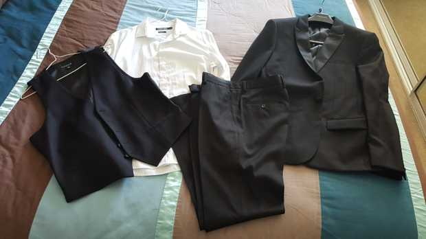 Full mens suit from Conners, only worn once. Jacket size 38 Pants size 31 Shirt size small Vest size...