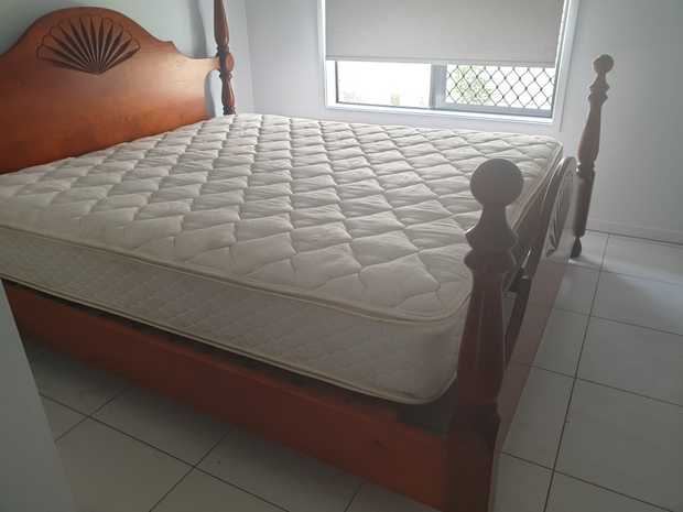 SOLID WOOD KING SIZE BED BOUGHT FROM HARVEY NORMAN SLAT BED WITH MATTRESS & 2 BEDSIDE TABLES