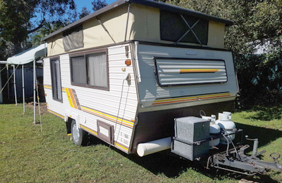 Coromal 15' pop top, 960 tare, single beds, solar, 3way fridge, new 4 burner grill, 1 pole tube...