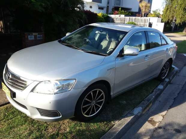 Auto. 6 cyl Sedan.