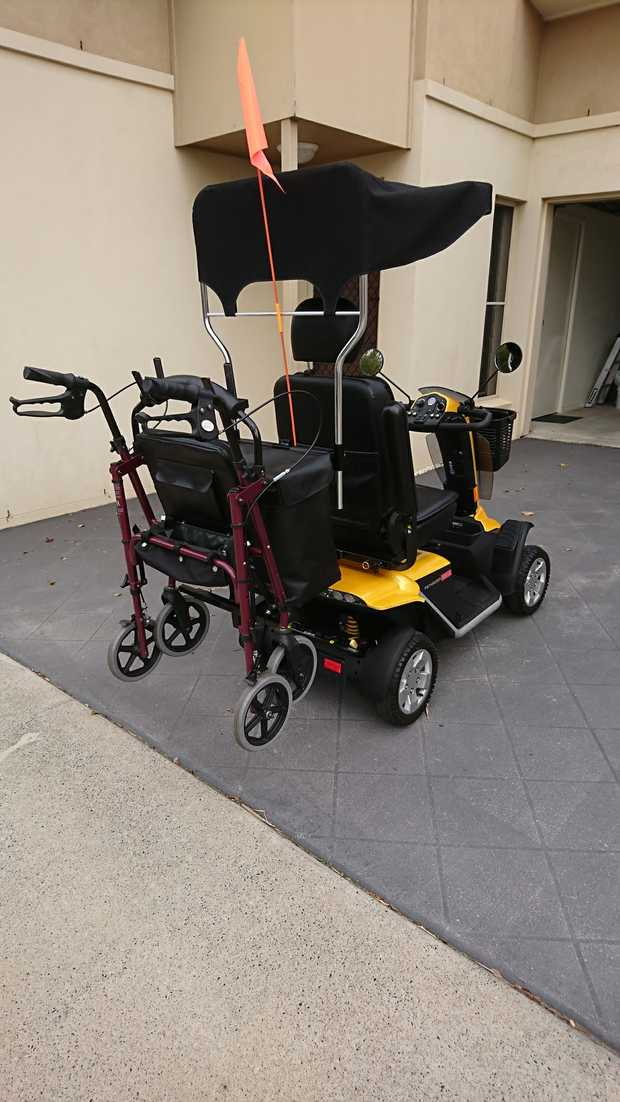 path rider 4 x L   yellow mobility scooter, hardly used , near new, comes with .safety  flag, basket on...