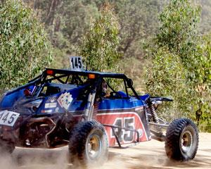 Hold on tight for 3 awesome Hot Laps in an Off Road V8 Race Buggy! You'll be suited up, helmet on...