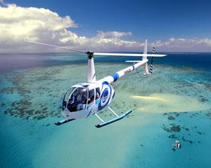 Experience the thrilling rush of helicopter flight as you take in the amazing sights of Cairns and...