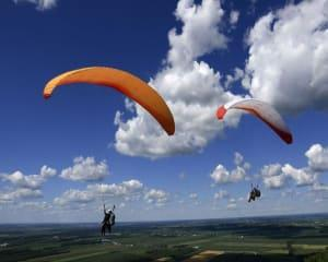 Experience the freedom of flight on the thermal wind patterns beneath you with a tandem paragliding...