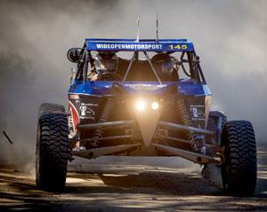 Hold on tight for 5 awesome Hot Laps in an Off Road V8 Race Buggy! You'll be suited up, helmet on...