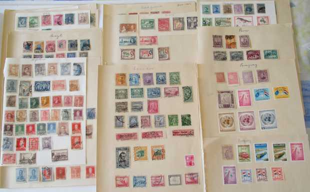 Worldwide stamps from large number of countries. Majority are postmarked and hinged. Also many surplus...