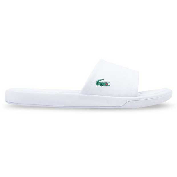 The L.30 Slide 217 from Lacoste is a casual poolside slide featuring a printed synthetic canvas strap...