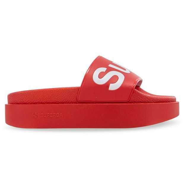 The recipe: take a Superga Pool Slide and add on an elevated platform sole. More is more. + PU...
