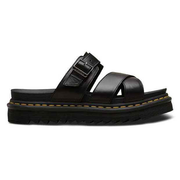 The Dr. Martens Ryker is a simple strappy sandal featuring crossed forefoot straps and a buckled ankle...