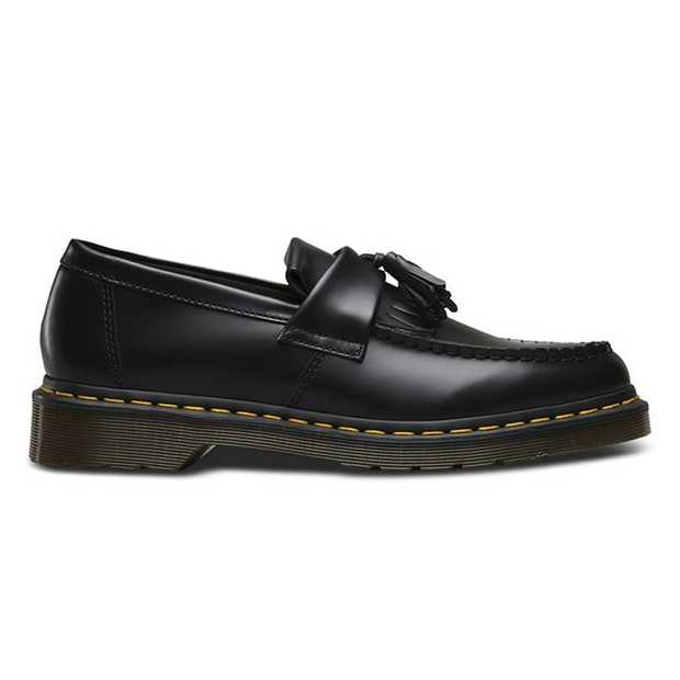 Dr. Martens' Adrian is a loafer style shoe recalling Ivy Style with its folded kiltie tassel flap and...