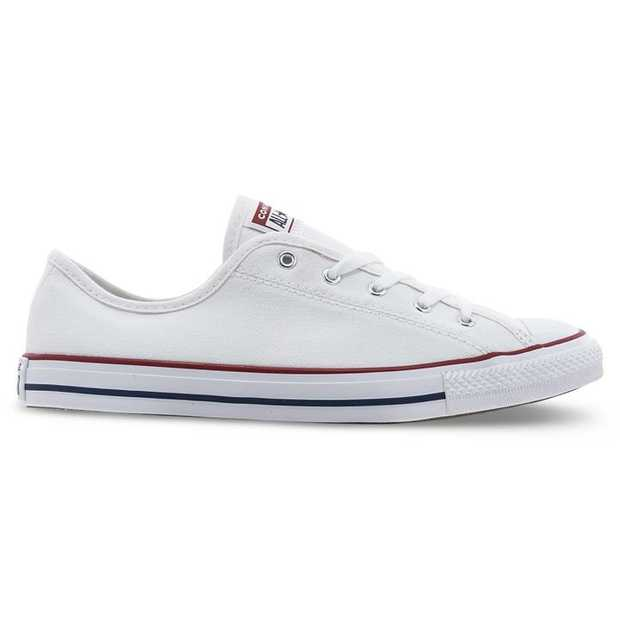 The All Star Dainty Ox from Converse features a full canvas upper, rubber toe cap design and slim...