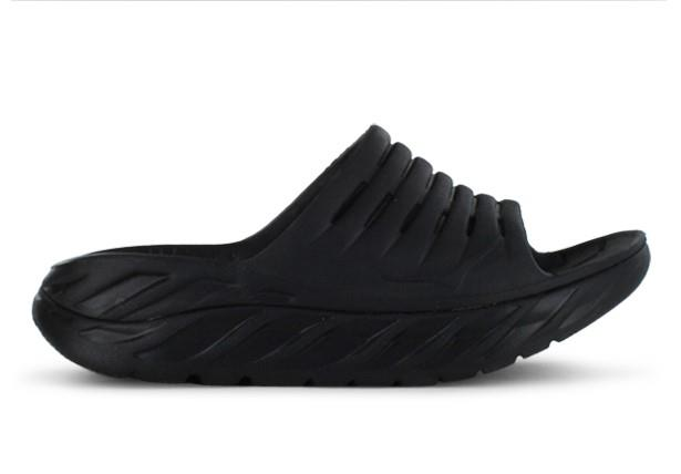 A Hoka One One oversized midsole and Meta-Rocker in a slide. Maximum comfort and support when you need...