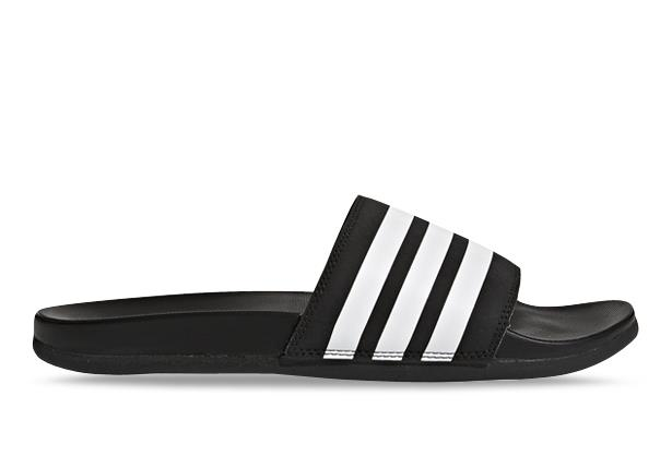 The adidas Adilette Comfort Womens slides rejuvenate tired feet. The lightweight slides have a...