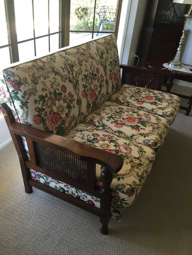 Three seater linen upholstered lounge with carved timber arms in good condition Additional matching...