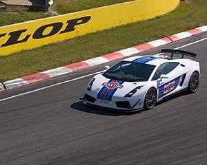 Start your engine and feel the incredible power of a Lamborghini race car as you take off around...