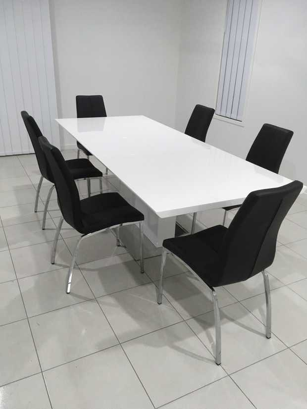 6 seater white table with chrome pedestal, expandable to seat 8. In near new condition. Chairs are...