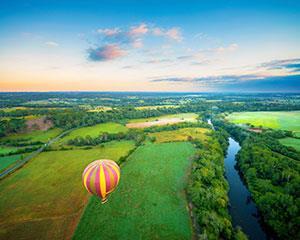 Experience the exhilaration of a sunrise hot air balloon flight over the beautiful Sydney Macarthur...
