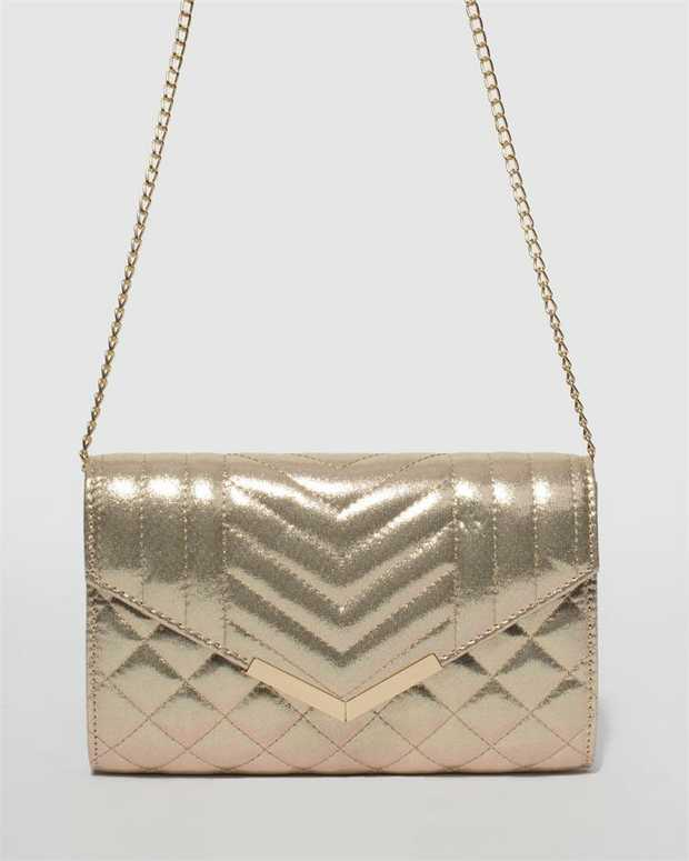 Part of our Belle of the Ball collection Gold finish with gold tone hardware Quilted material Magnetic...