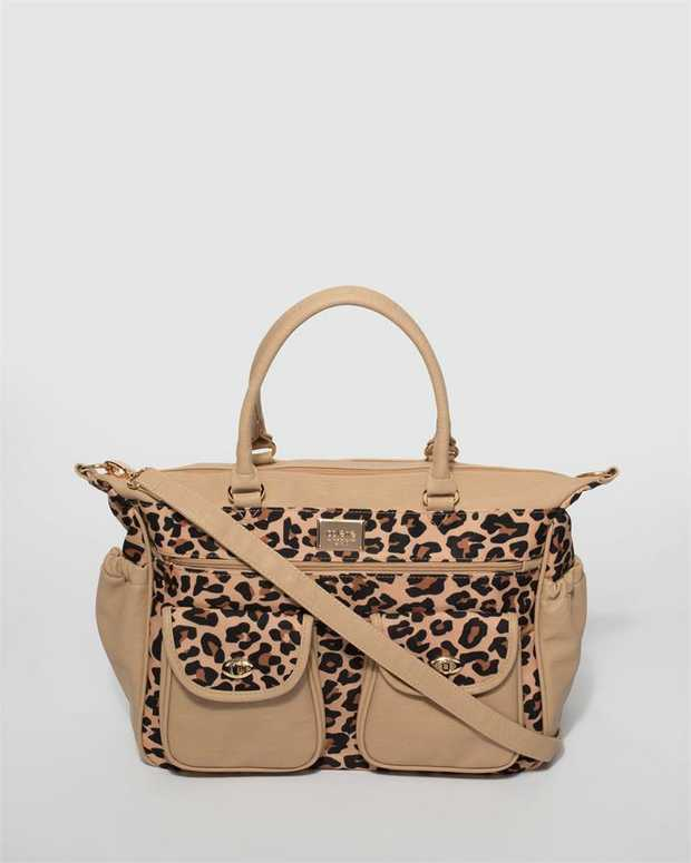 Part of our Baby Bags collection Print finish with gold tone hardware Leopard print faux leather Zip...