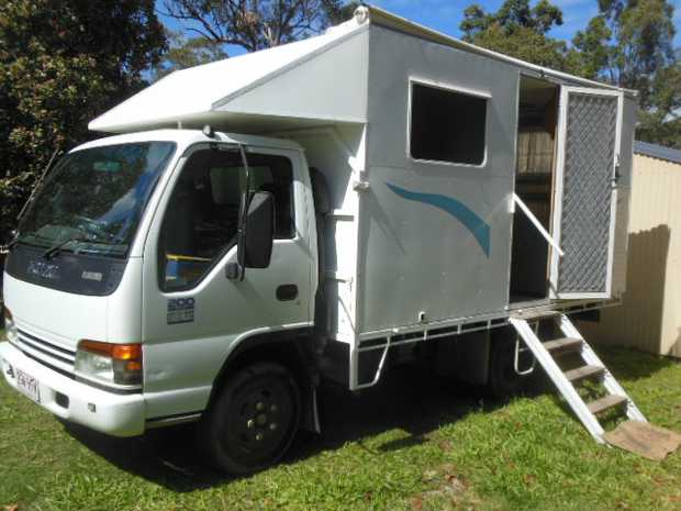 ISUZU NPR 200 truck, 3.9m tray with a 4.0m slide on motorhome.