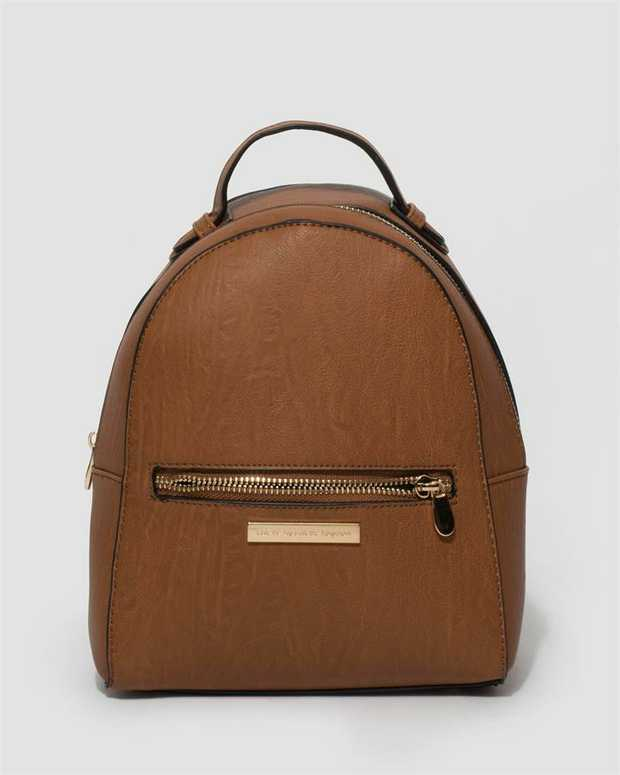 Part of our Mini Backpack collection Tan finish with gold tone hardware Smooth faux leather Zip secures...