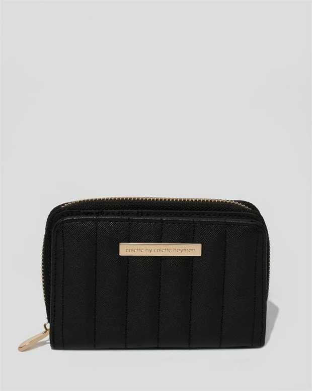 Black finish with gold hardware Textured faux leather Press stud closure; front Zip around closure;...