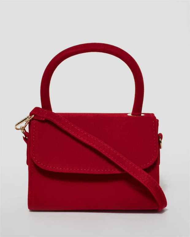 Part of our Mini collection Red finish with gold tone hardware Velvet material Magnetic closure...