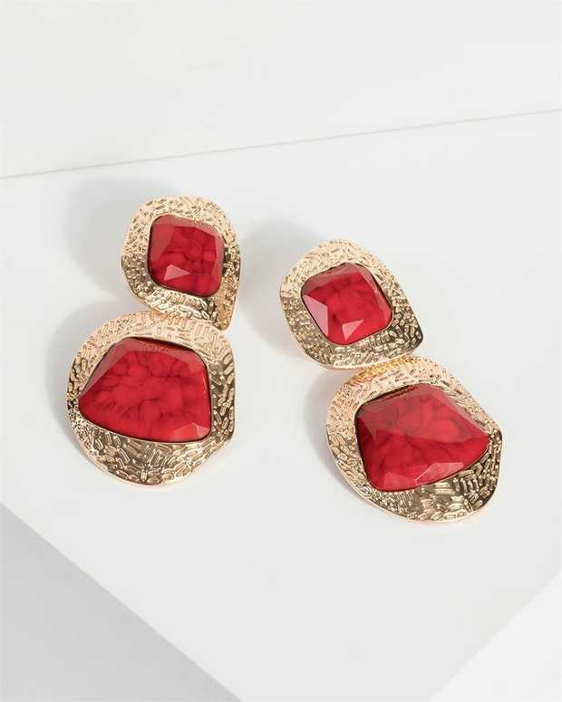 Part of our Comin in Hot collection Make a fashion statement with our gorgeous earrings. This red large...