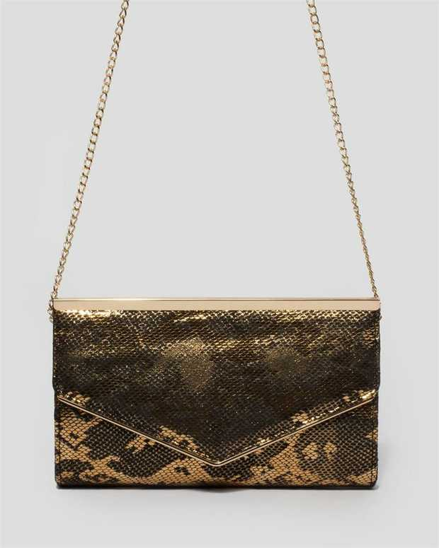 Part of our Gold Python collection Bronze finish with glass tone hardware Python metallic faux leather...