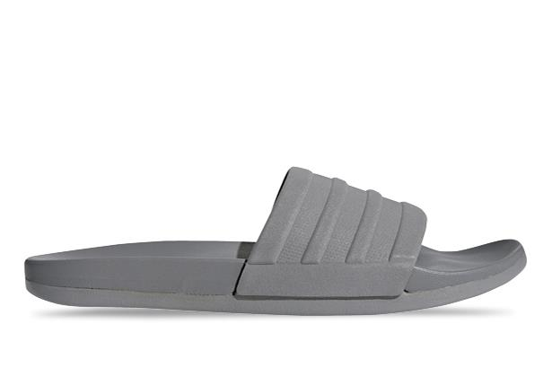 The adidas Adilette Comfort Men's slides rejuvenate tired feet. The lightweight slides have a Cloudfoam...